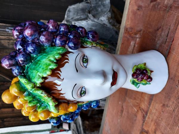 Donatello Grape figural lady